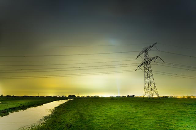 a field with a powerline