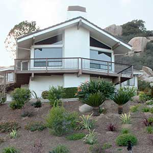 A private house with a xeriscape instead of a front lawn. Hidden Meadows, California.