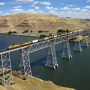 A long grain train of the Union Pacific Railroad crossing a bridge in Washington State.
