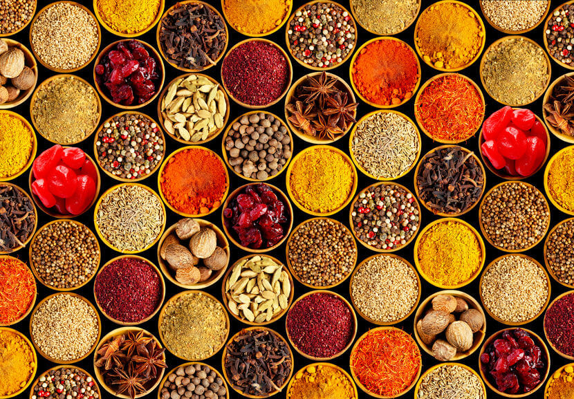 Different spices on black background