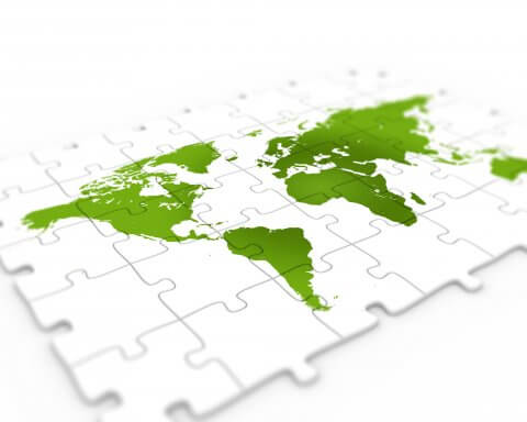 Green world map on puzzle