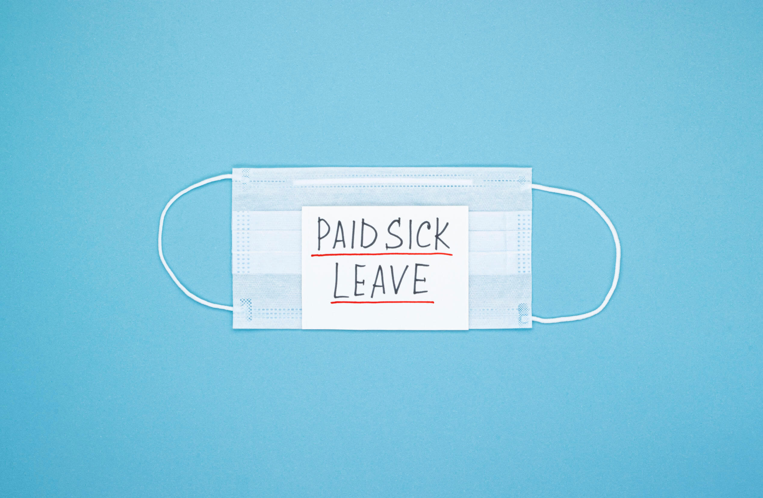 """Surgical mask with """"paid sick leave"""" note"""